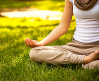 Young attractive female meditate Stock Photo