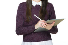 Young attractive female professional drawing with stylus pen on digital tablet Royalty Free Stock Photography