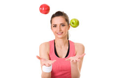 Young attractive female with red and green apple Stock Image
