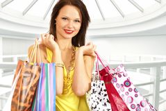 A young and attractive female with shopping bags Stock Images