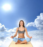 Young and attractive female sportsman meditating Royalty Free Stock Images