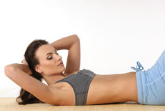 Young and attractive female sportsman training Royalty Free Stock Photos