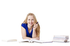 Young, attractive female student learning at floor Royalty Free Stock Images