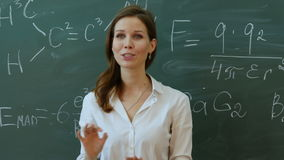 Young attractive female teacher of maths interacting with her young primary school students asking for an answer. stock footage