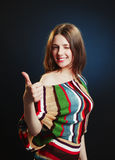 Young attractive female with thumbs-up Stock Photo