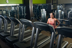 Young attractive female working out in a gym Royalty Free Stock Photography