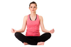 Young attractive female in yoga meditation pose Royalty Free Stock Photography