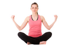 Young attractive female in yoga meditation pose Stock Photos