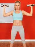 Young Attractive Fitness Woman Lifting Weights Royalty Free Stock Photography