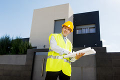 Young attractive foreman worker supervising building blueprints smiling happy outdoors Royalty Free Stock Image