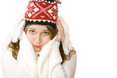 Young attractive freezing woman with cap and scarf Royalty Free Stock Photo