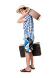 A young, attractive gay guy with glasses and two suitcases ready Stock Photos