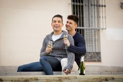 Young attractive gay men couple celebrating together Valentines day or anniversary champagne toast Stock Photos
