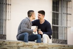 Young attractive gay men couple celebrating together Valentines day or anniversary champagne toast Royalty Free Stock Photos