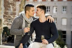 Young attractive gay men couple celebrating together Valentines day or anniversary champagne toast Royalty Free Stock Image
