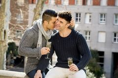 Young attractive gay men couple celebrating together Valentines day or anniversary champagne toast Stock Images