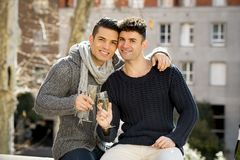 Young attractive gay men couple celebrating together Valentines day or anniversary champagne toast Royalty Free Stock Photo