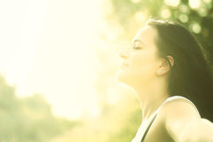 Young attractive girl bathing in sunlight Stock Photos
