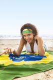 Young attractive girl on beach with Brazil flag. Young attractive girl in bikini on beach with Brazil flag Stock Images