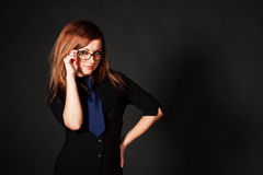 Young attractive girl in black blouse Royalty Free Stock Photography
