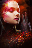 Young attractive girl in bright art-makeup, body painting. Profile Stock Images