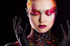 Young attractive girl in bright art-makeup, body painting. Profile Royalty Free Stock Photos