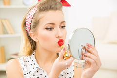 Young attractive girl busy with her make up. Stock Image