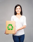 Young and attractive girl with a cardboard box Stock Images