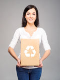 Young and attractive girl with a cardboard box Stock Photos