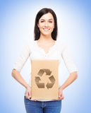 Young and attractive girl with a cardboard box Stock Photography