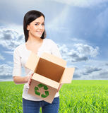 Young and attractive girl with a cardboard box Royalty Free Stock Photos