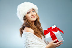 Young attractive girl in Christmas style over grey Royalty Free Stock Image