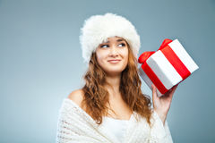 Young attractive girl in Christmas style over grey Stock Images