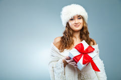 Young attractive girl in Christmas style over grey Royalty Free Stock Images