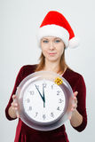 Young attractive girl with a clock Royalty Free Stock Photos