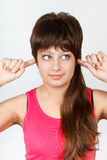 Young attractive girl covers her ears Royalty Free Stock Photos