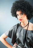Young attractive girl with  curly haircut. Young attractive girl with afro curly haircut Royalty Free Stock Photography