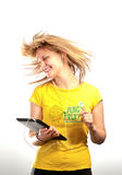 Young attractive girl dancing with a mp3 player Stock Photography