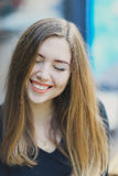 Young attractive girl with dimples smile and looks down close eyes with long blond hairn Stock Image