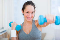 Young attractive girl doing exercise at home Stock Photo