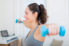 Young attractive girl doing exercise at home Royalty Free Stock Images