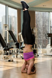 Young Attractive Girl Doing The Headstand Royalty Free Stock Images