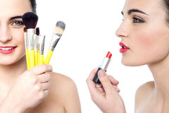 Young attractive girl doing make-over Royalty Free Stock Photos