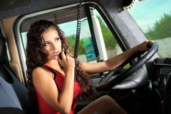 Young attractive girl drive big truck Royalty Free Stock Photography
