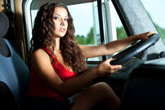 Young attractive girl drive big truck Stock Photography