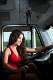 Young attractive girl drive big truck Royalty Free Stock Photo