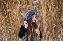 Young attractive girl embracing the snow in winter. Winter portr Royalty Free Stock Images