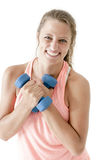 Young attractive girl exercising with pair of dumbbells Royalty Free Stock Photo