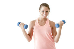 Young attractive girl exercising with pair of dumbbells Stock Image