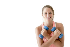 Young attractive girl exercising with pair of dumbbells Royalty Free Stock Image